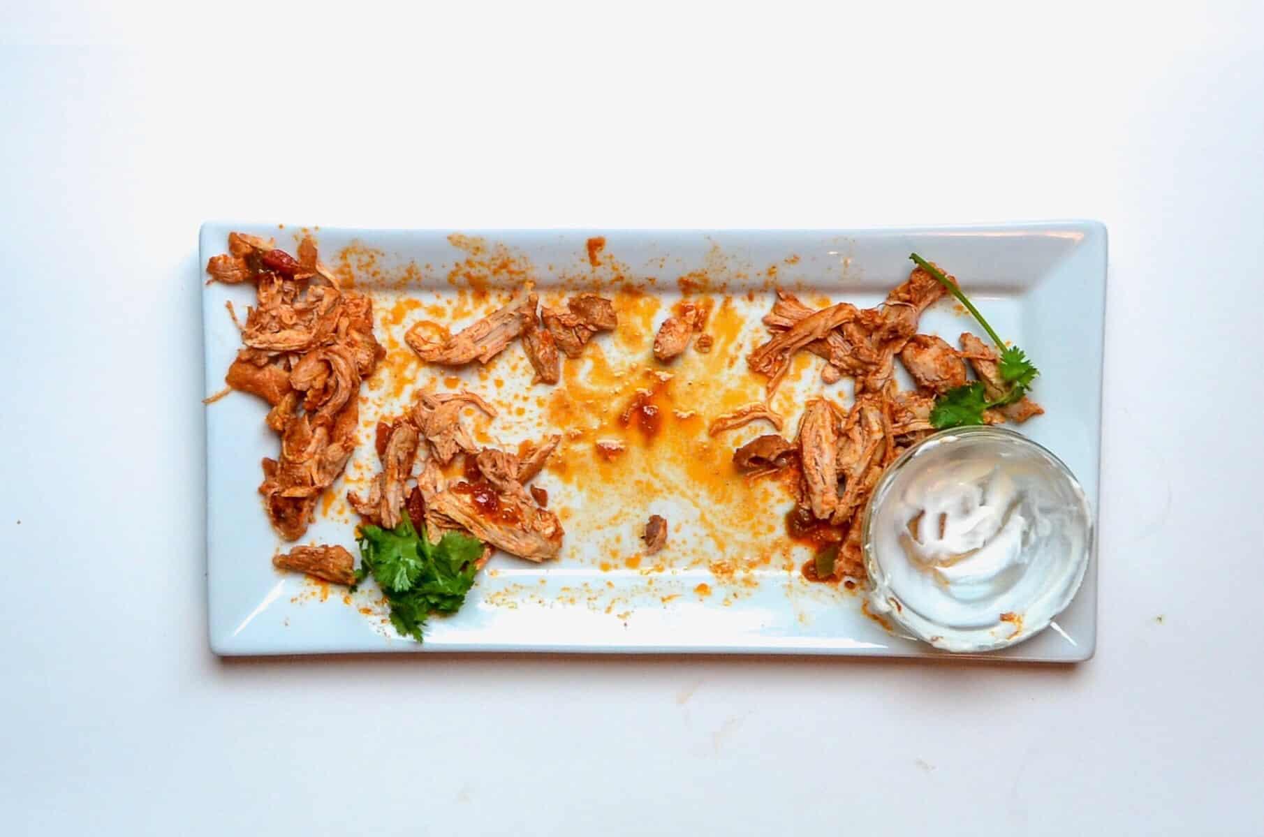 empty platter of shredded chicken.