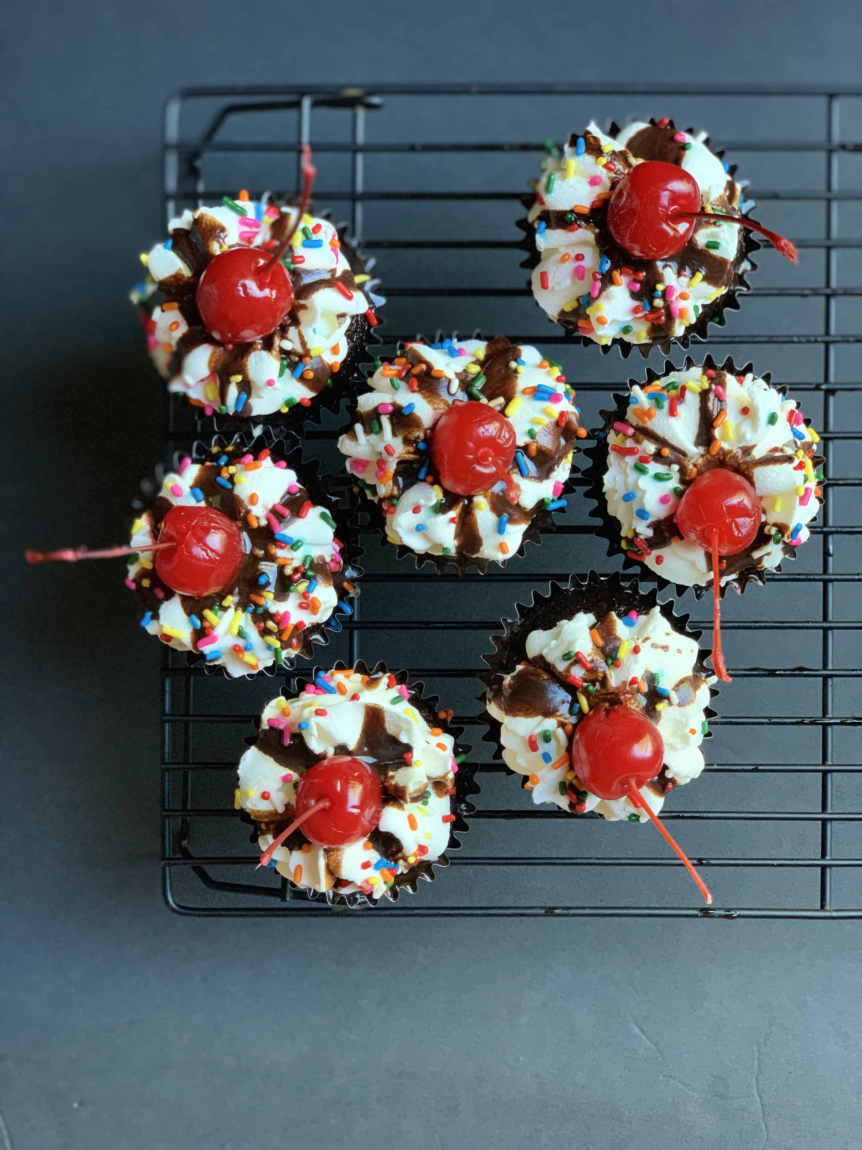 aerial view of 7 hot fudge sundae cupcakes