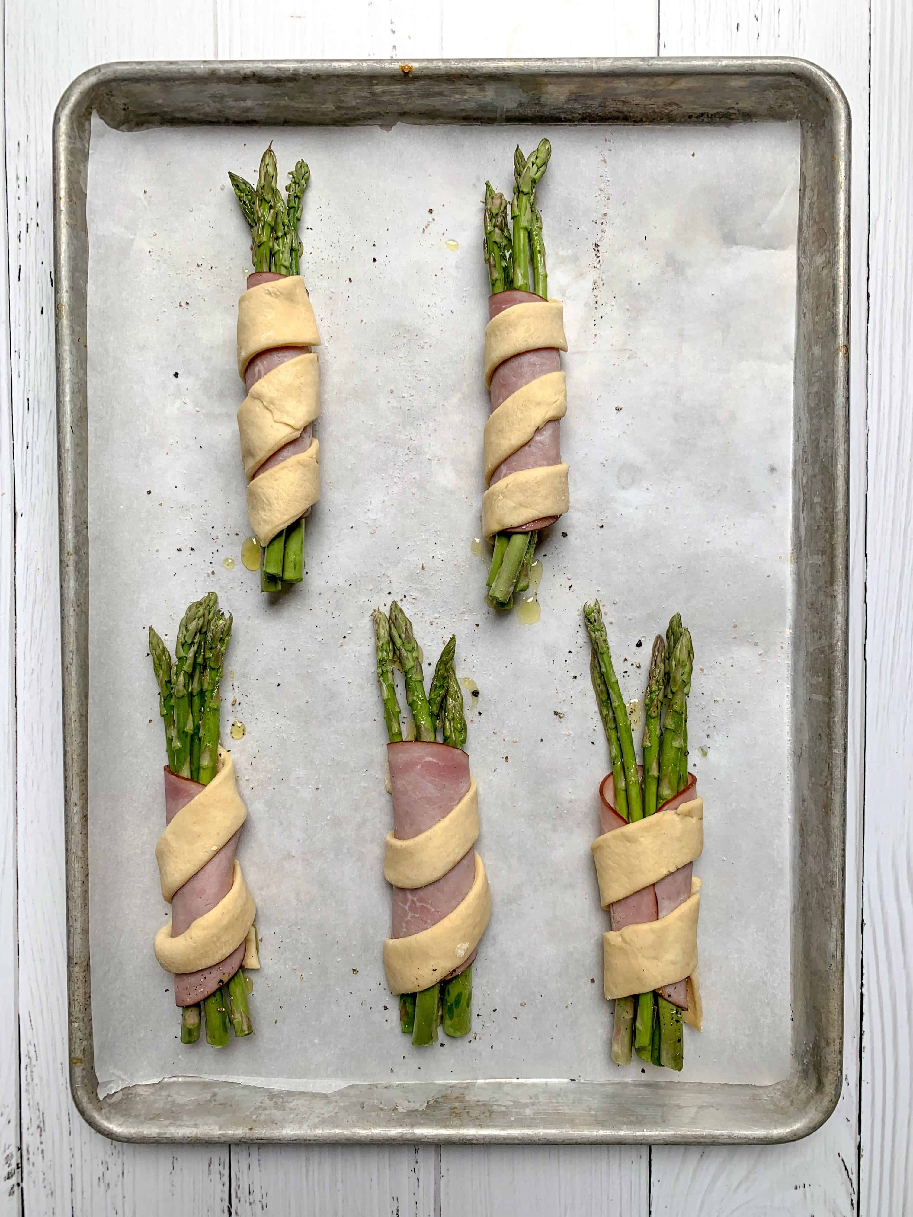 aerial view of the bundles of wrapped asparagus before being baked.