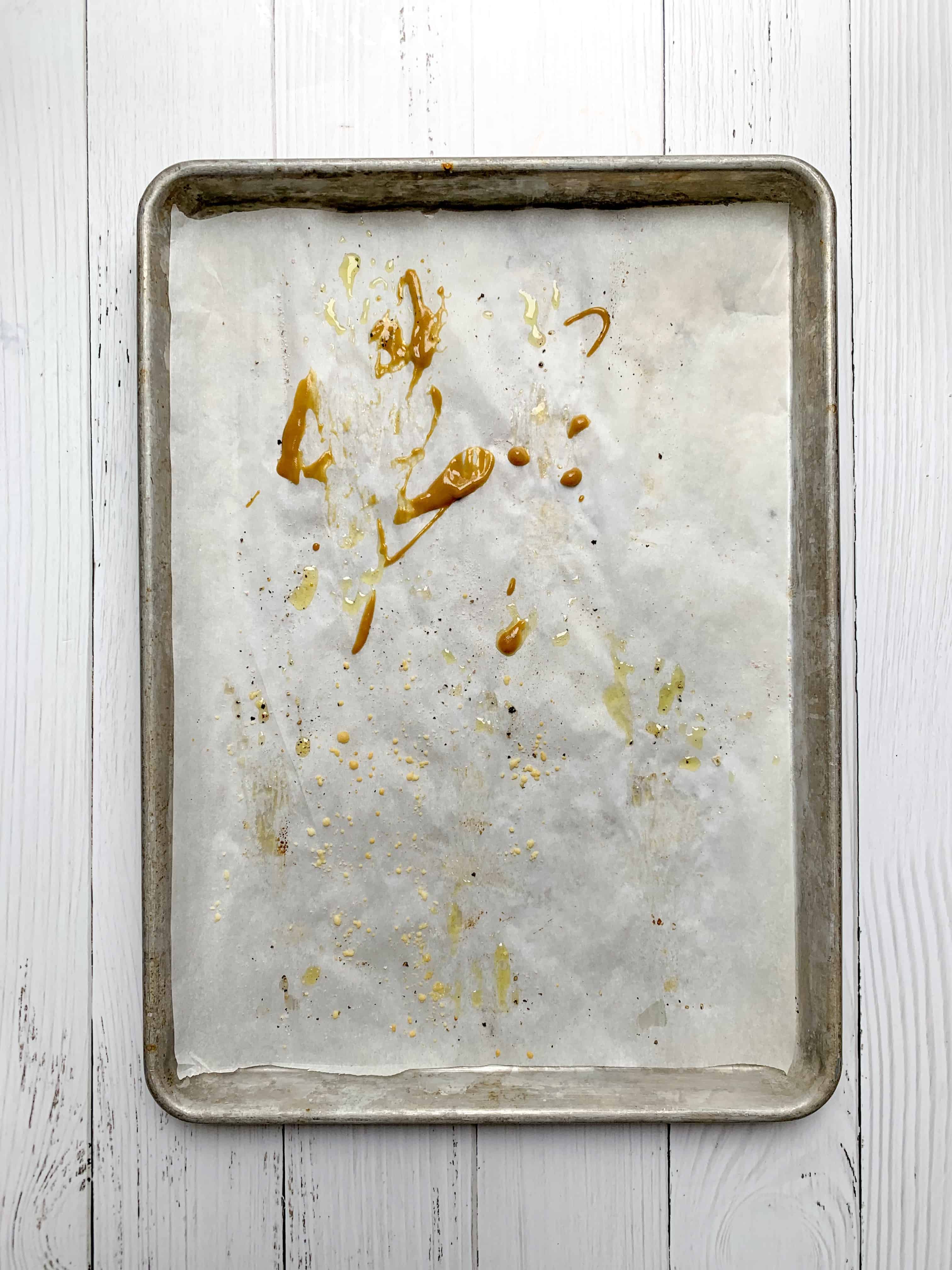 empty baking tray with only a little bit of honey mustard splatters