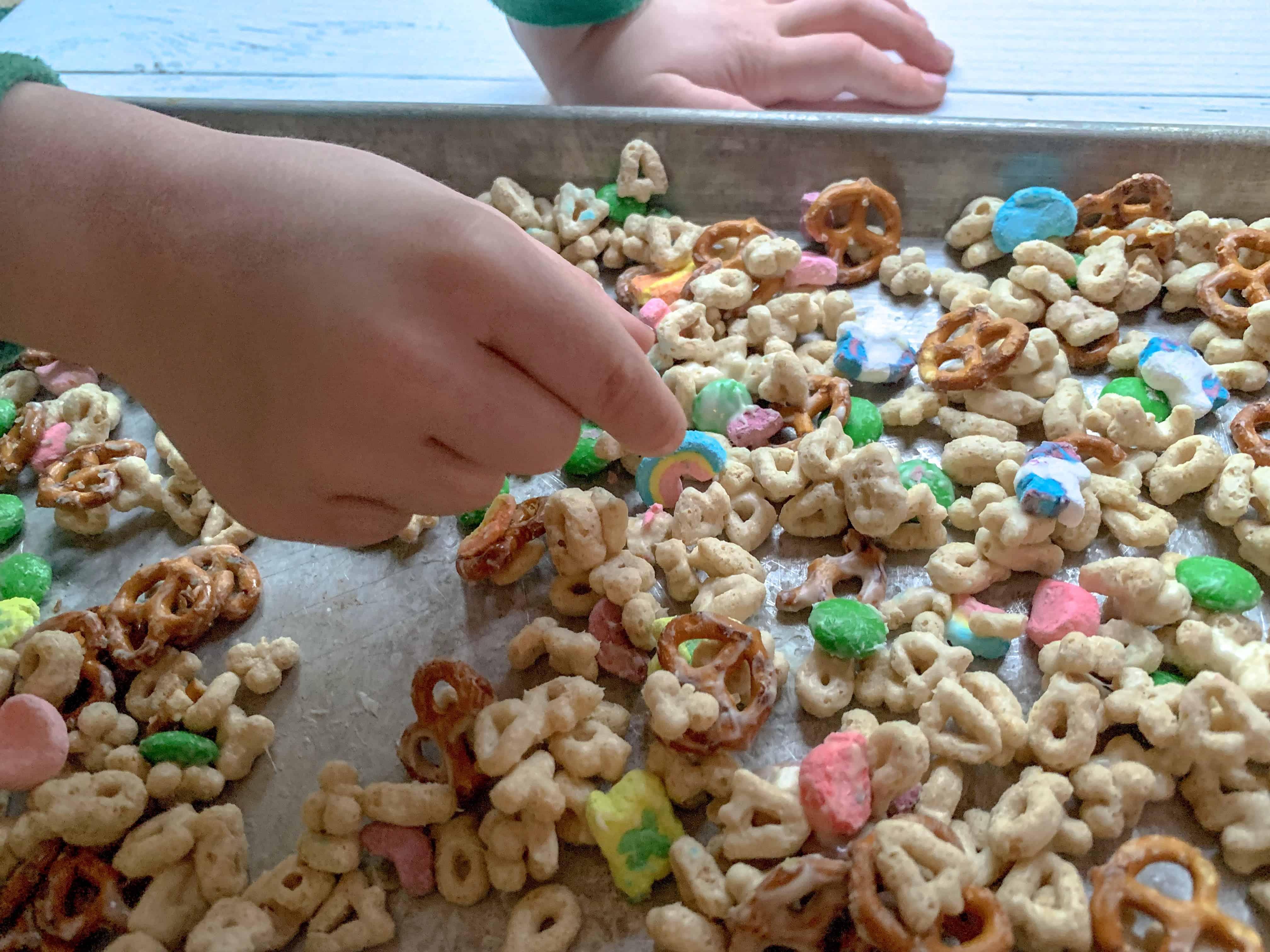 kiddos hands in leprechaun bait