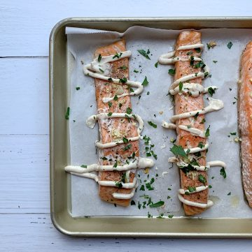 slow roasted salmon with lemon herb tahini dressing
