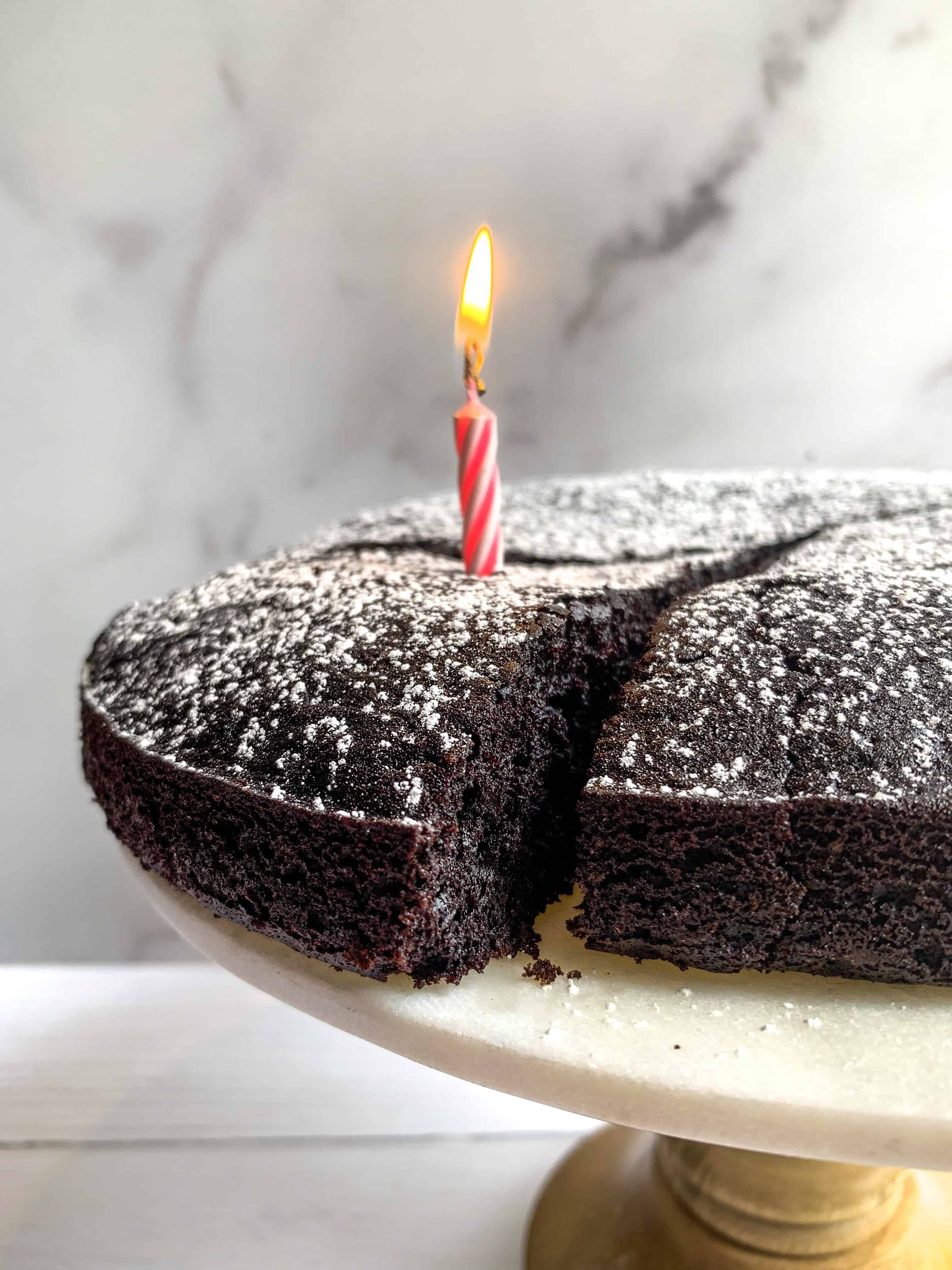 dairy free chocolate cake on stand