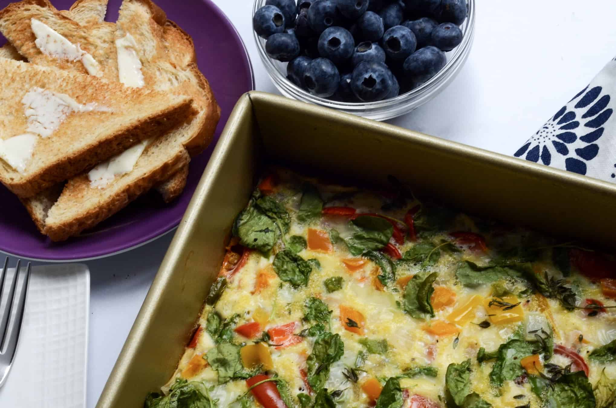 egg and vegetable breakfast bake with toast and blueberries