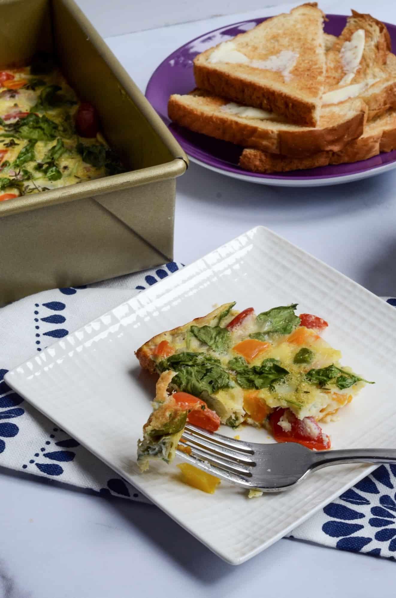 slice of egg and vegetable breakfast bake