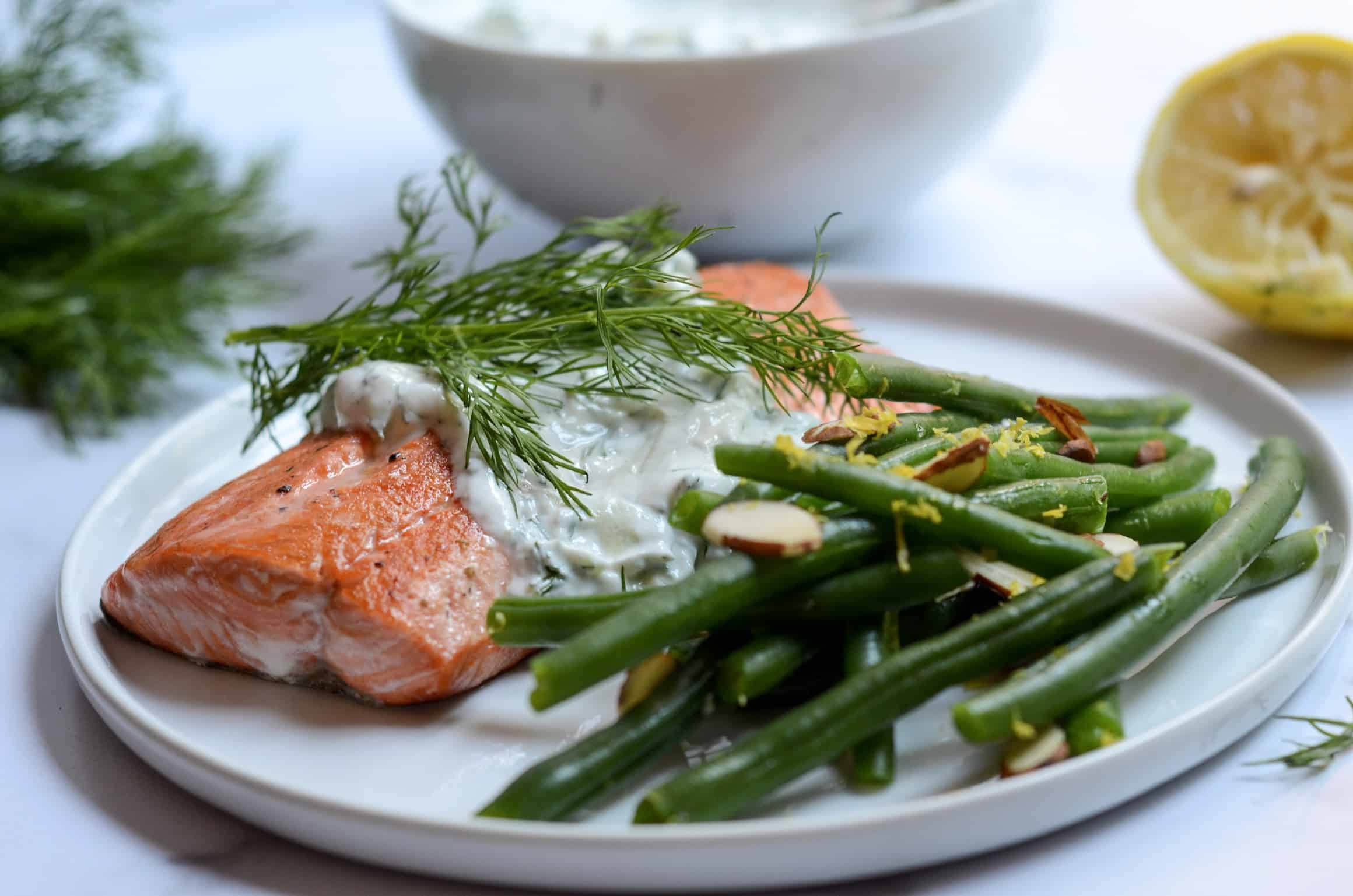 plate of slamon with Tzatziki and green beans
