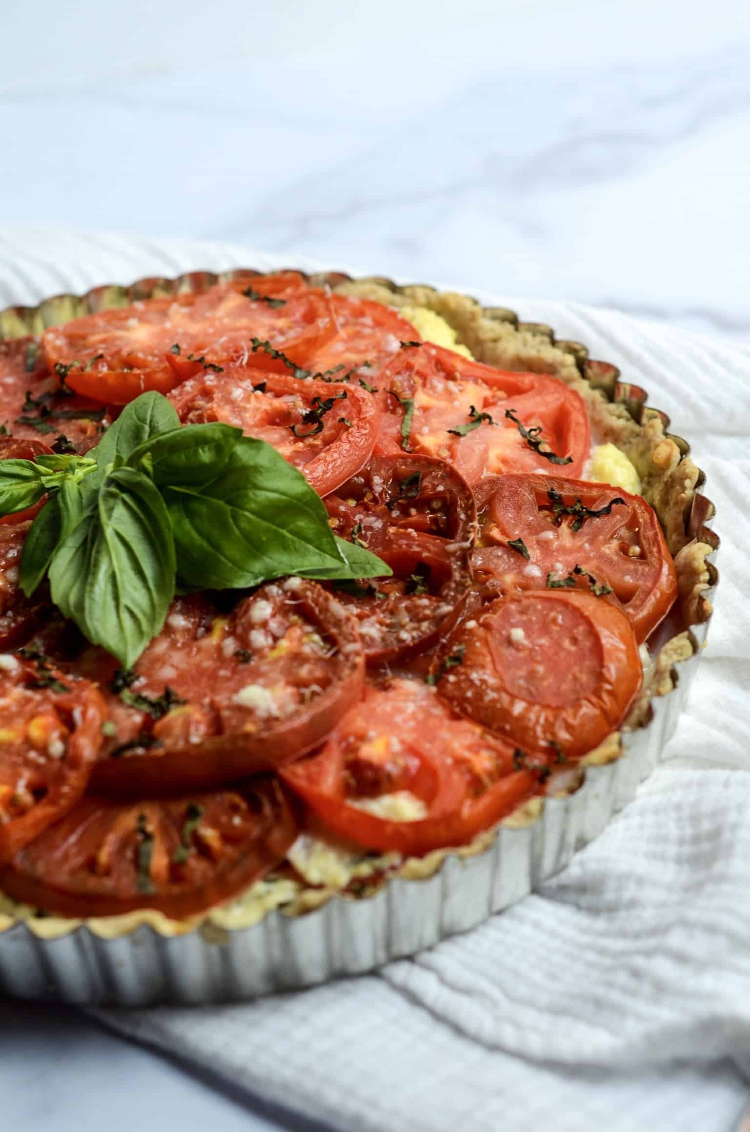parmesan and basil on tomato pie