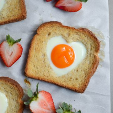 egg in a hole toast that's heart shaped