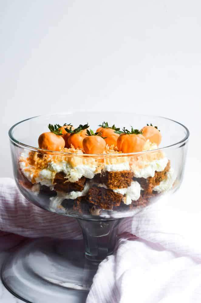 side view of large clear bowl filled with easter trifle dessert.