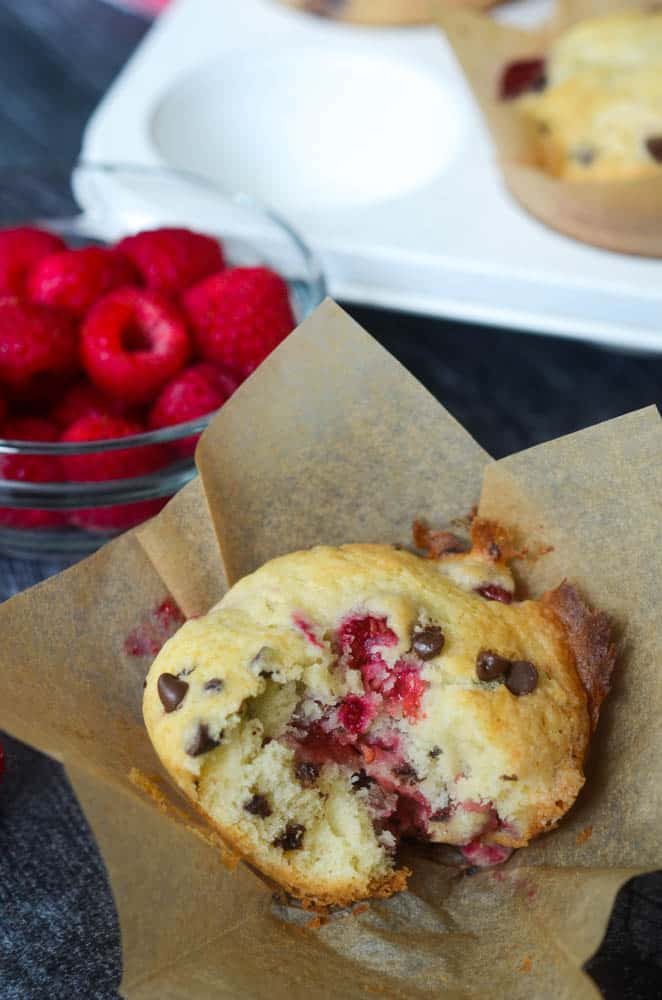 up close picture of raspberry chocolate chip muffin bitten into