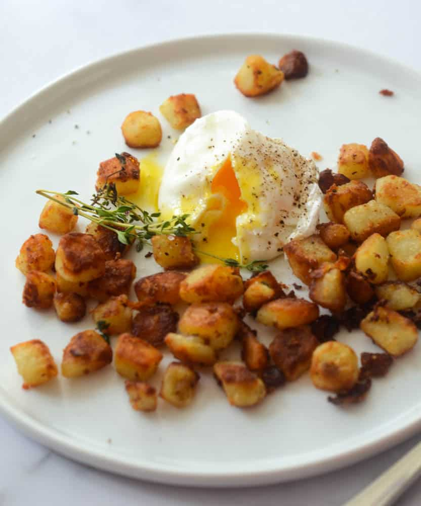 up close picture of southern fried potatoes with poached egg