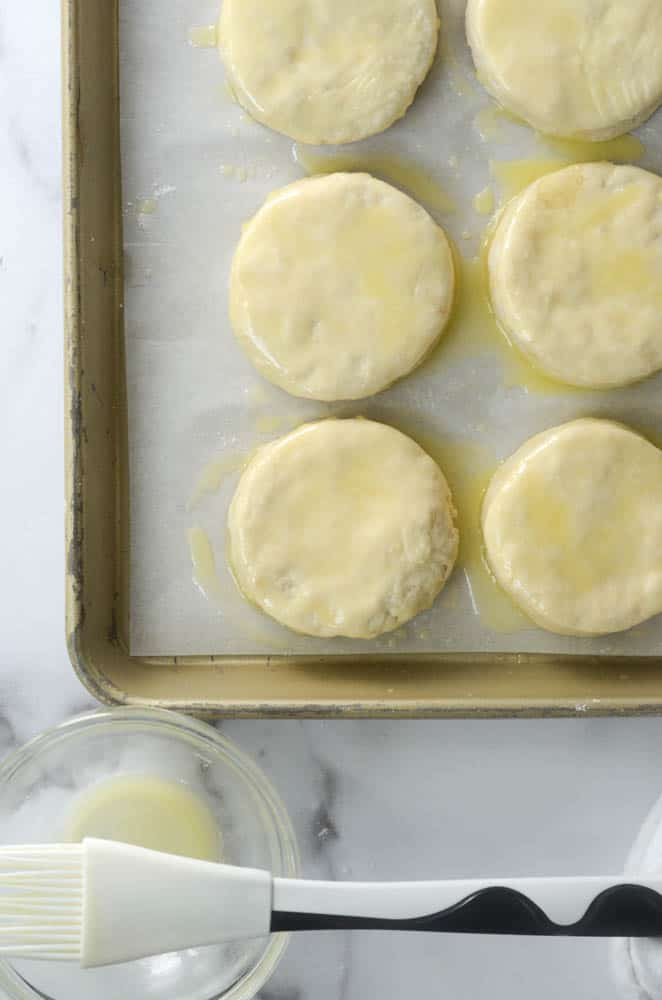 aerial shot of cut biscuit dough covered with butter on top