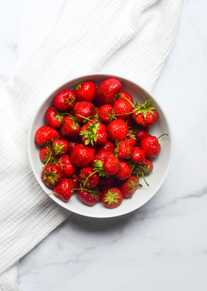 flatlay of bowl of fresh strawberries