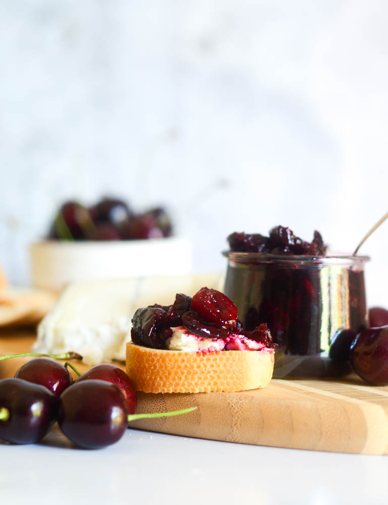 cherry compote, cherries, and baguette with cheese nad cherry compote on top.
