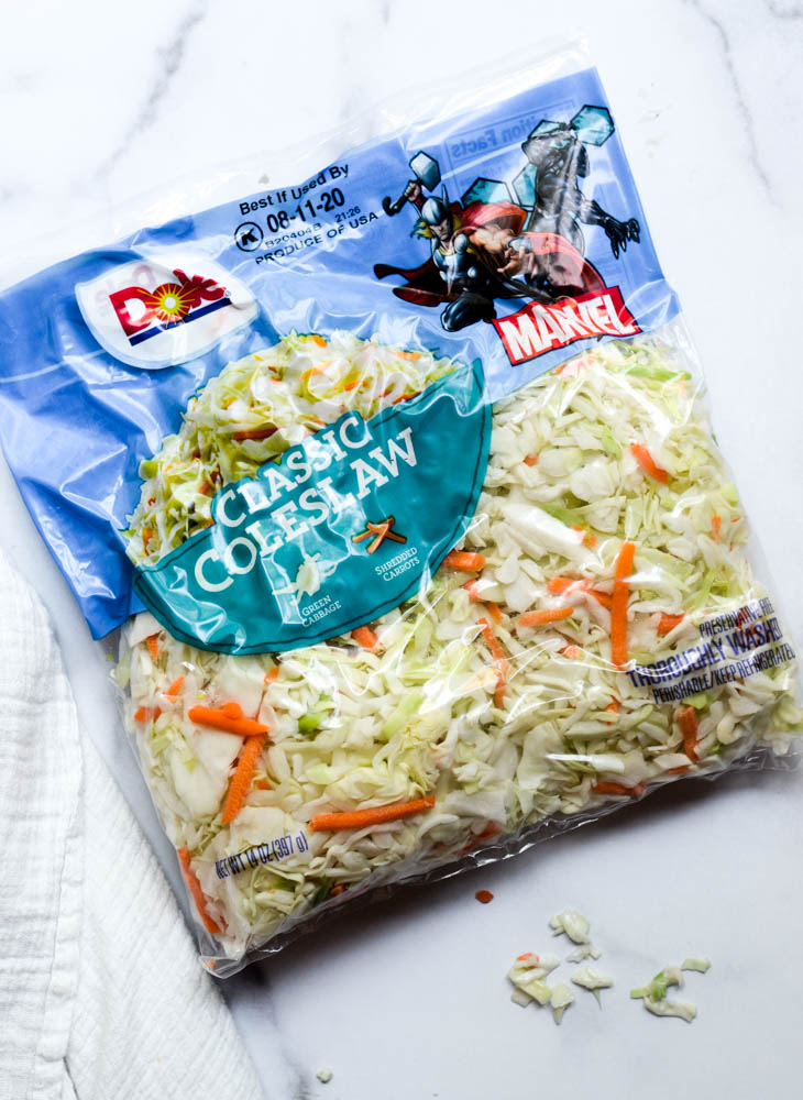 bag of dole classic coleslaw mix on white marble background
