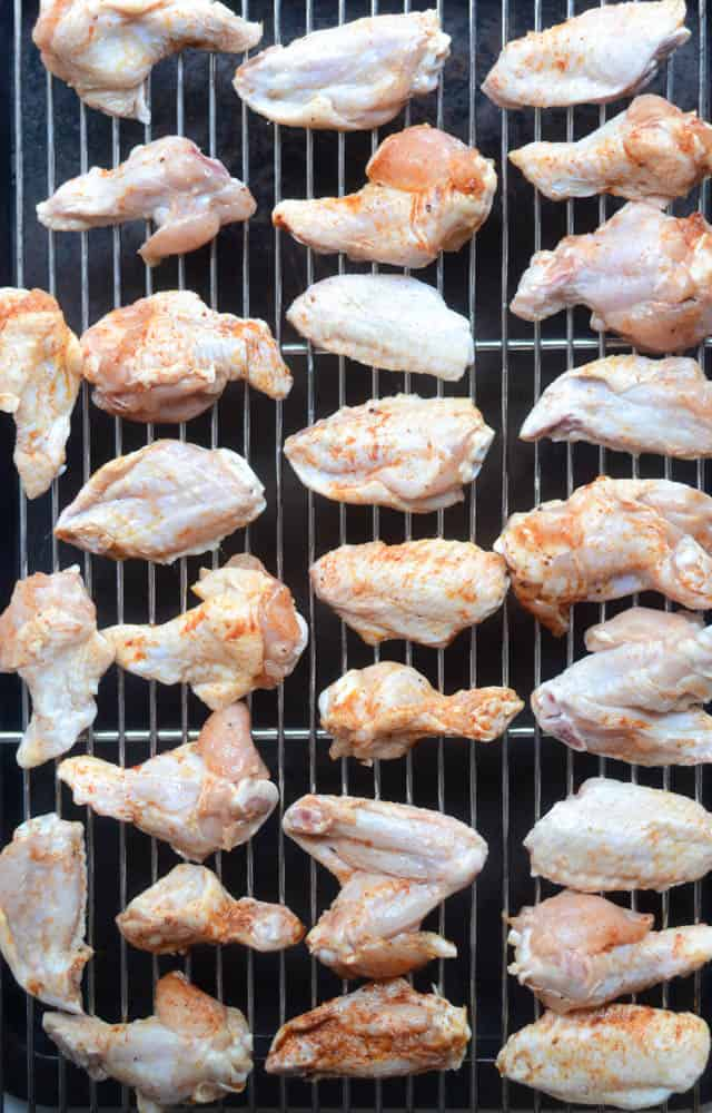 aerial view of chicken wings before cooking them on wire rack