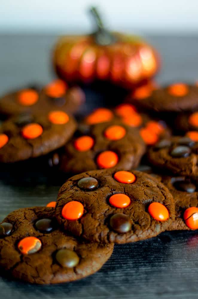 close-up of one of the chocolate cookies with brown and orange M&Ms.