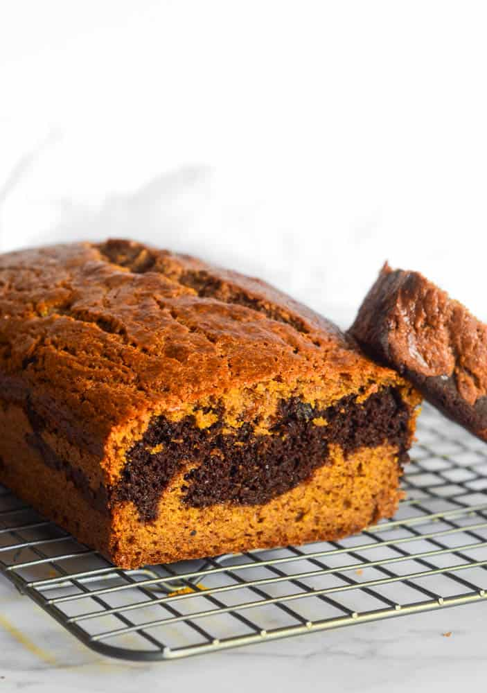 side view of pumpkin chocolate bread on wire rack.