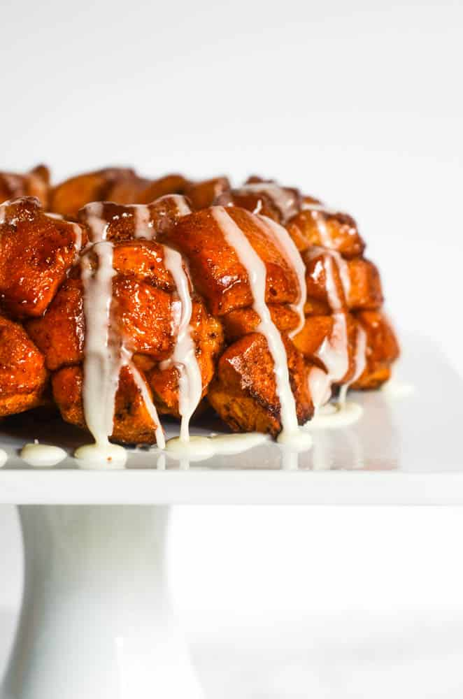 up close side picture of monkey bread drizzled with icing.